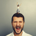 Woman dancing on the head of shouting man Royalty Free Stock Images