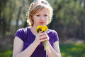 Woman with dandelion blonde at outdoor Royalty Free Stock Images