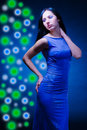 Woman is in a dark blue evening dress Royalty Free Stock Photos