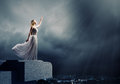 Woman in darkness young reaching to sun light Royalty Free Stock Photo