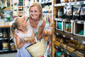 Woman with daughter buying cookies in store Royalty Free Stock Photo