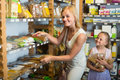 Woman with daughter buying pasta in store Royalty Free Stock Photo
