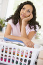 Woman Daydreaming Over Washing Basket Royalty Free Stock Image