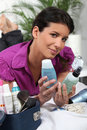 Woman deciding which beauty products to pack Royalty Free Stock Image