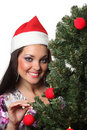 Woman decorate a christmas tree Stock Photo