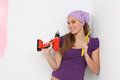 Woman decorating house with cordless electric drill and tape measure happy Royalty Free Stock Photography