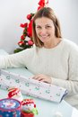 Woman with decorative wrapper at home portrait of beautiful during christmas Royalty Free Stock Image