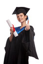 A woman with a degree in her hand as she looks at the camera isolated Royalty Free Stock Photo