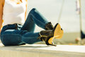 Woman in denim pants heels shoes outdoor Royalty Free Stock Photo