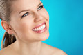 Woman dental care teeth cure and whitening portrait of beauty with healthy toothy smile over blue background Stock Image