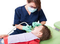 Woman dentist doctor working with child patient Royalty Free Stock Photo