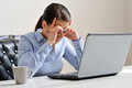Woman depressed at work business feeling photo has a larger depth of field with focus on her eyes Stock Images