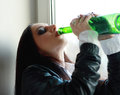 Woman in depression drinking alcohol alone young drink Royalty Free Stock Photography