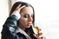 Woman in depression drinking alcohol alone young drink Stock Photo