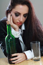Woman in depression drinking alcohol young crying drink dark tone image Stock Photography