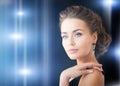 Woman with diamond earrings Stock Photography