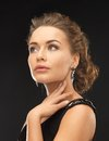 Woman with diamond earrings beautiful in evening dress wearing Stock Photography