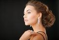 Woman with diamond earrings beautiful in evening dress wearing Stock Image