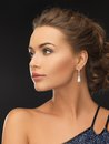 Woman with diamond earrings beautiful in evening dress wearing Stock Photo