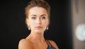Woman with diamond earrings beautiful in evening dress wearing Stock Photo