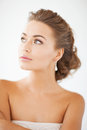 Woman with diamond earrings beautiful in white dress and Royalty Free Stock Image