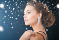 Woman with diamond earrings jewelry luxury vip nightlife party concept beautiful in evening dress wearing Royalty Free Stock Images
