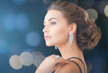 Woman with diamond earrings jewelry luxury vip nightlife party concept beautiful in evening dress wearing Royalty Free Stock Image