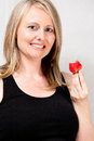 Woman on diet eating strawberry a happily a Royalty Free Stock Photography