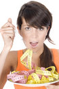 Woman diet eating a tape mesure Royalty Free Stock Photos