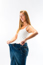 Woman on diet with oversized pants Royalty Free Stock Image