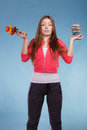 Woman with diet weight loss pills and vegetables. Royalty Free Stock Photo