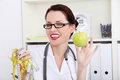 Woman dietician holding apple and  measuring tape Royalty Free Stock Photography