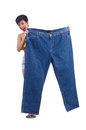 Woman in dieting concept with big jeans Royalty Free Stock Photos