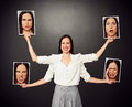 Woman with different emotional faces smiley four hands holding pictures Royalty Free Stock Photos