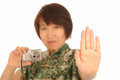 Woman with digital camera Stock Photo
