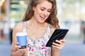 Woman with digital tablet and coffee attractive Stock Photography