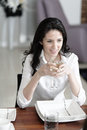 Woman at the dinner table attractive elegant enjoying a meal Royalty Free Stock Photo