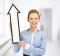 Woman with direction arrow sign Royalty Free Stock Photos