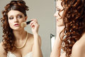 Woman directs a make up the young in the morning before wedding Royalty Free Stock Images