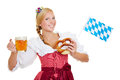 Woman in dirndl with beer happy young and pretzel and a bavarian flag Royalty Free Stock Photos
