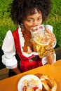 Woman in Dirndl drinking beer Stock Image