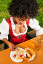 Woman in Dirndl drinking beer Royalty Free Stock Photo