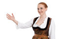 Woman in dirndl isolated informed and pointing at something presenting with hand on white Royalty Free Stock Image