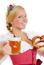 Woman in dirndl with pretzel and beer happy young a mug of Royalty Free Stock Images