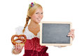 Woman in dirndl with pretzel and blackboard happy young a empty Royalty Free Stock Photography