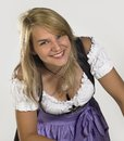 Woman in a dirndl smiling blond wearing traditional dress named Stock Image