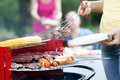 Woman dishing out tasty chuck steak Royalty Free Stock Photo