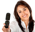 Woman displaying a cell phone Royalty Free Stock Photos