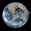 Woman diving on the planet earth Royalty Free Stock Photo