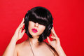 Woman dj listening to music on headphones enjoying Royalty Free Stock Photo